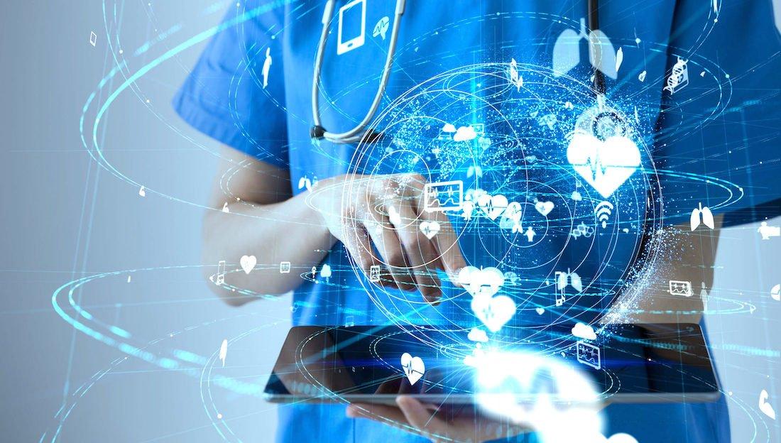 A doctor using a digital health app on tablet