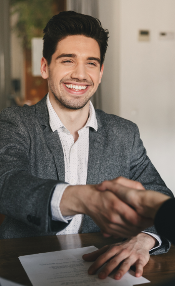 Happy man shaking hands with employee after interview